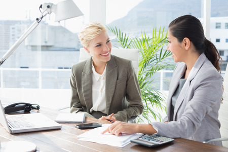 working attire: Businesswomen working together in an office