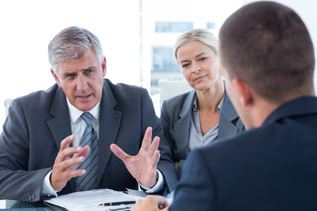 business suit: Business people conducting an interview in an office Stock Photo
