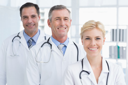 medical doctors: Doctors smiling at camera in medical office