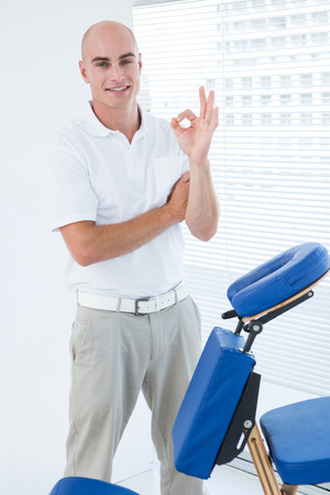 massage chair: Doctor in front of medical chair in medical house