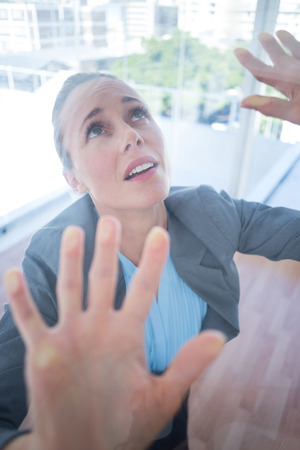 apprehensive: Businesswoman feeling trapped in an office