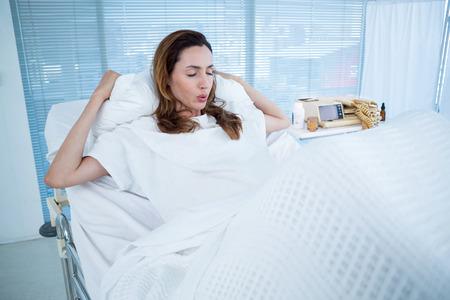 pangs: Pregnant woman having birth pangs in hospital room