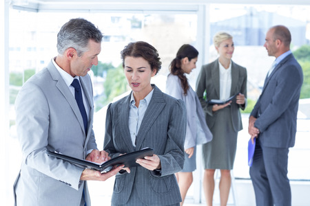 negotiating: business people negotiating  in the office