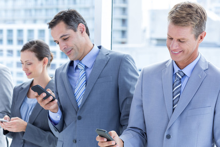 phone message: Employees using their mobile phone in the office
