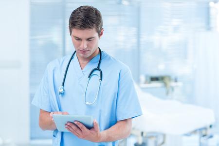 Doctor holding tablet in hospital