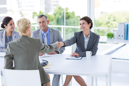 interview: Interview panel listening to applicant in the office