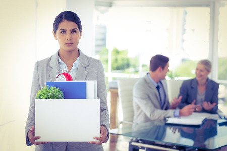 let go: Businesswoman after being let go in the office