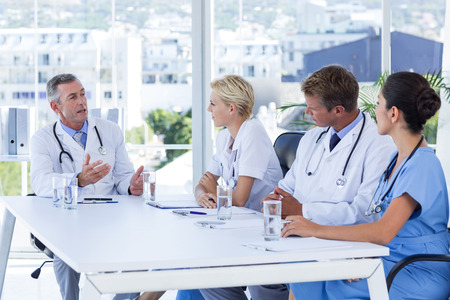 Team of doctor discussing together during meeting in medical office