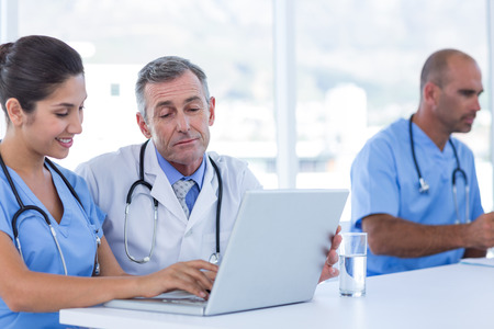 medical doctors: Doctors using computer in medical office