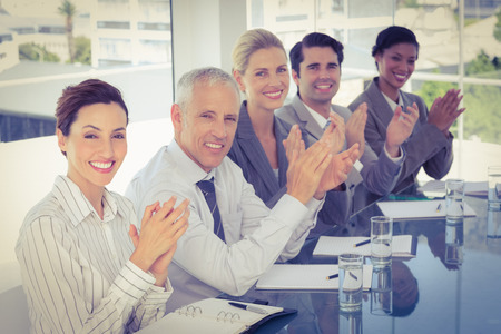 acclamation: Business team applauding during conference in the office