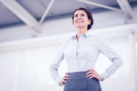 joyful businessman: Smiling businesswoman standing in the office
