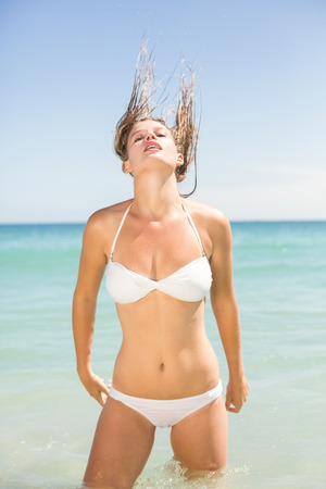 tossing: Pretty blonde tossing her hair at the beach Stock Photo