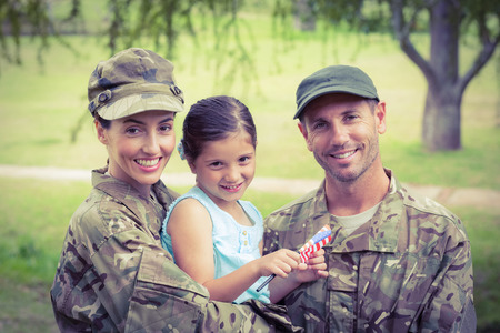 Army parents reunited with their daughter on a sunny day Banque d'images