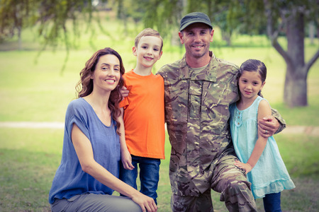soldier: Handsome soldier reunited with family on a sunny day