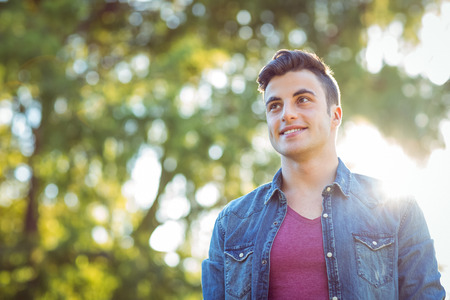 green man: Handsome hipster looking to the distance on a sunny day Stock Photo