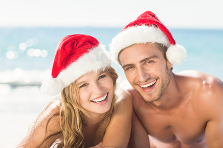 guy on beach: happy couple with Christmas hat on the beach Stock Photo