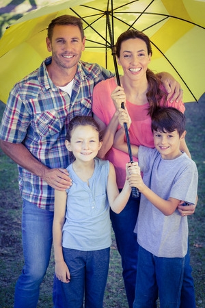 happy family nature: Happy family in the park together on a sunny day Stock Photo
