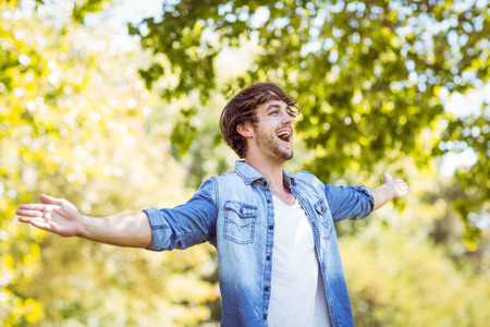 freedom nature: handsome hipster feeling free in the park on a summers day Stock Photo