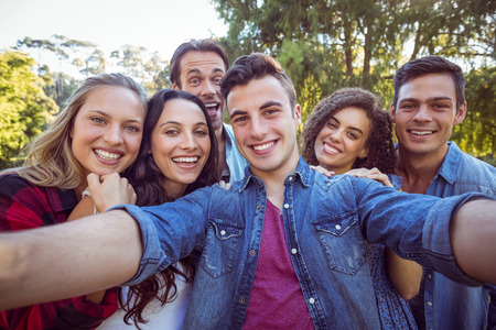 friendship tree: Happy friends taking a selfie on a summers day