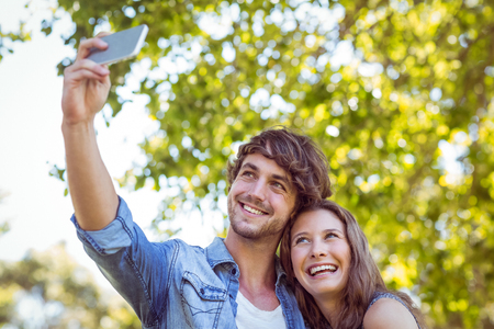 summers: Hipster couple taking a selfie on a summers day