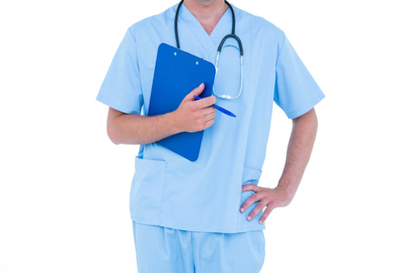 tunic: Standing young nurse in blue tunic on a white background
