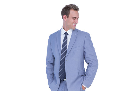 hands on pockets: Happy handsome businessman smiling with hands on pockets on white background Stock Photo