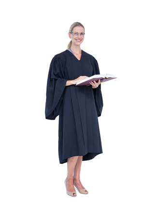 female lawyer: Happy pretty lawyer holding labor code on white background Stock Photo