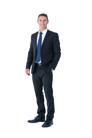 middleaged: Businessman looking at camera with hand in pocket on white background