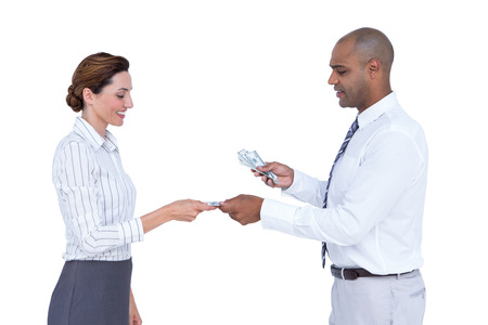 Business people exchanging bank notes on white background