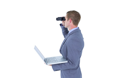 using binoculars: Businessman using binoculars against a white background