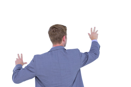 turned out: Businessman gesturing with hands on a white background