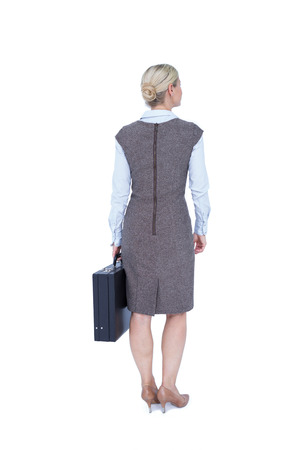 turned: Back turned businesswoman holding a briefcase on a white background