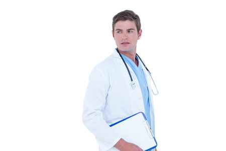 tunic: Thinking young nurse in blue tunic on a white background Stock Photo
