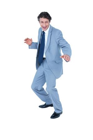 gesturing: Happy businessman gesturing on white background
