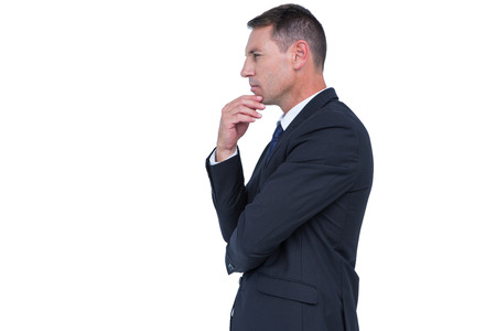 hand on the chin: Serious businessman thinking with hand on chin on white background