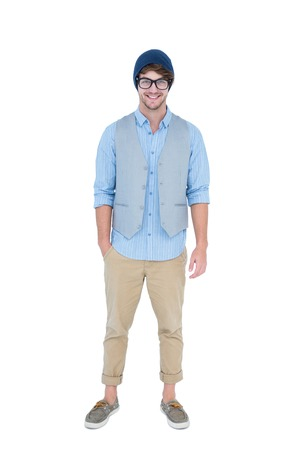 hand in pocket: Geeky hipster looking at camera with hand in pocket on white background Stock Photo