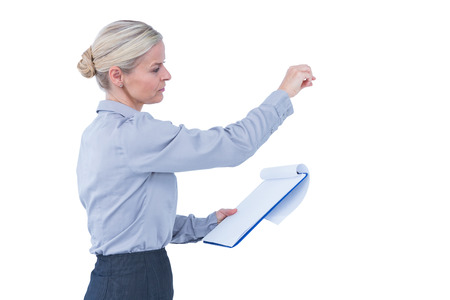 Businesswoman gesturing and holding clipboard on white background Stock Photo