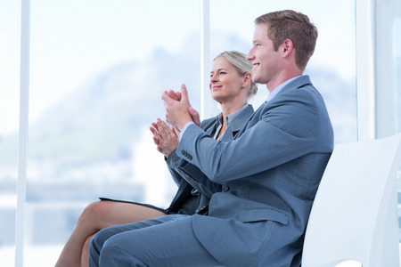 acclamation: Business people applauding during meeting in office Stock Photo
