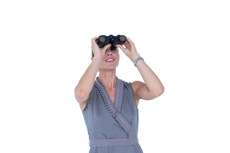 looking through: Businesswoman looking through binoculars against a white background