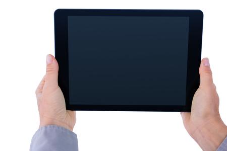 Businesswoman holding digital tablet on white background Stock Photo