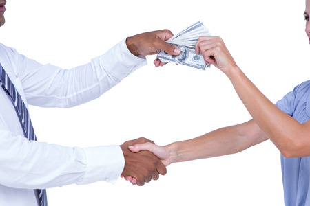 Business people shaking hands and exchanging bank notes on white background