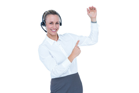 businesswoman suit: Smiling businesswoman with headset pointing on white background Stock Photo