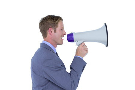 businessman using a megaphone: Handsome businessman talking through megaphone