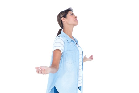 escapism: Side view of pretty brunette with arms outstretched on white background