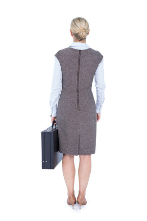 turned out: Back turned businesswoman holding a briefcase on a white background