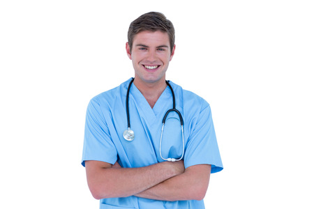 tunic: Young nurse in blue tunic with arms crossed on a white background Stock Photo