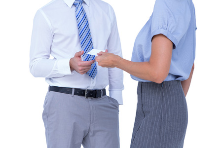 exchanging: Business people exchanging business card on white background Stock Photo