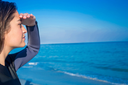 wetsuit: Woman in wetsuit on a sunny day at the beach Stock Photo