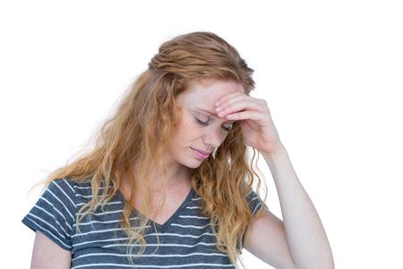 unsmiling: Blonde woman having headache on white background