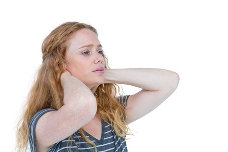wincing: A blonde woman having neck pain on white background